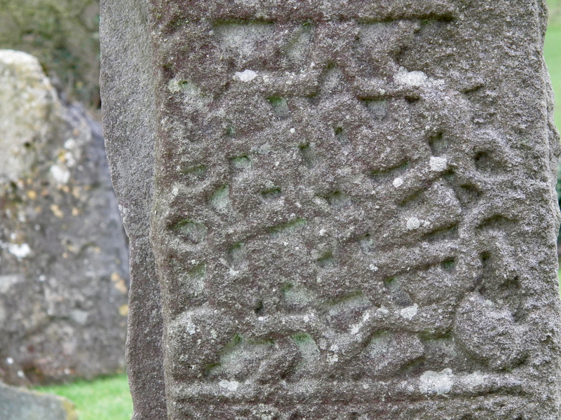 an example of human interlace. There are four human figures, a head in each corner of the panel on the west face. The arms and legs are interlaced in a completely unnatural way.