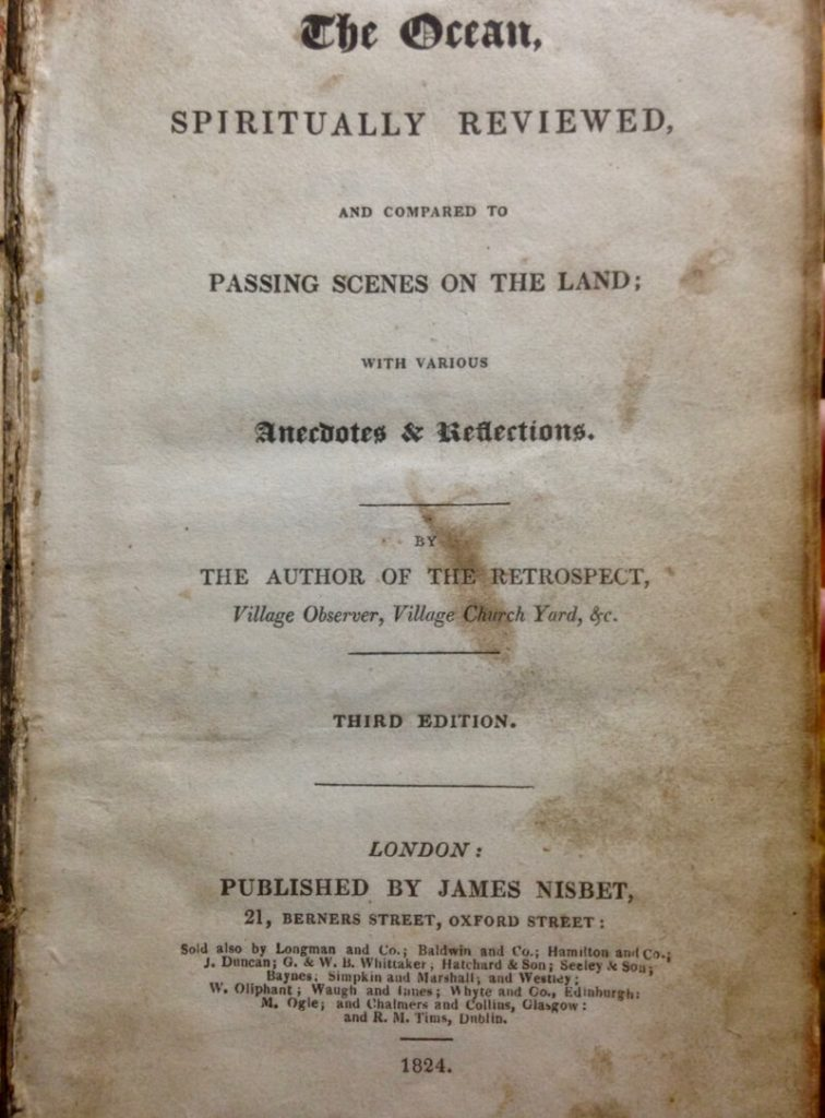 Photograph depicting the title page of the book 'The Ocean' by the author of the retrospective, ... printed in 1824. It looks old, the binding in the spine is exposed on the left. Were aware of the papers texture from the papers discolouring from light cream to graduating light browns towards the edge of the page right.